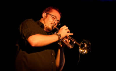 Member - Gregory Wilson-Copp on trumpet and backing vocals